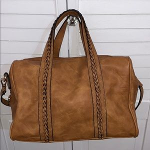 Tan satchel handbag with crossbody strap